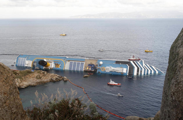 In this , Sunday, Jan. 22, 2012 file photo, the cruise ship Costa Concordia lies on its side off the Tuscan island of Giglio, Italy. Costa Crociere SpA says work to remove the capsized Costa Concordia