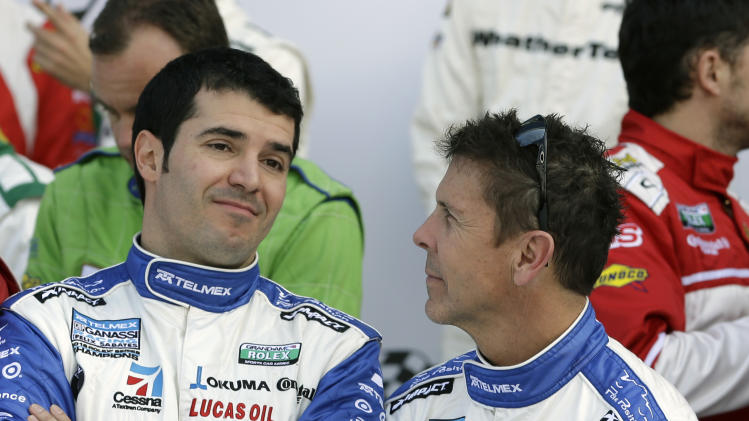 Ganassi Racing team driver's Memo Rojas, left, of Mexico, and Scott Pruett talk before a photo session after practice  for the Rolex 24 hour auto race at Daytona International Speedway, Friday, Jan. 25, 2013, in Daytona Beach, Fla. (AP Photo/John Raoux)