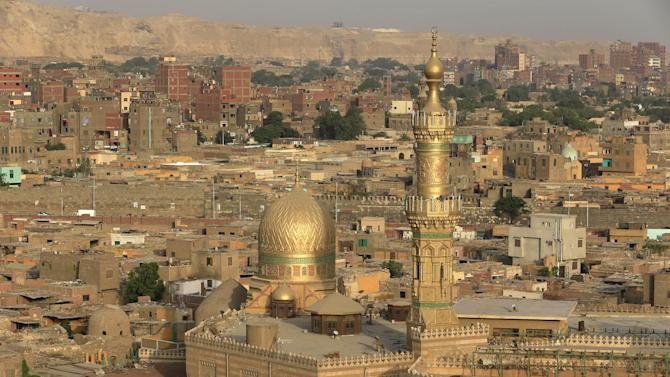 In this Tuesday, June 11, 2013 photo, a general view shows El Sayyeda Nafisa mosque, in Cairo, Egypt. Egypt's roughly 15 million Sufi Muslims say their places of worship are under threat by rising radicalism. They say that since the country's 2011 uprising that toppled longtime autocrat Hosni Mubarak, shrines held sacred to them have been attacked by hardliners who deem them heretical and idolatrous. Sayyida Nafisa bint Hasan ,Sayyida Ruqayya and Sayyeda Zeinab bint Ali, revered by Sufis, are traditionally considered the patron saints of Cairo. (AP Photo/Hassan Ammar)