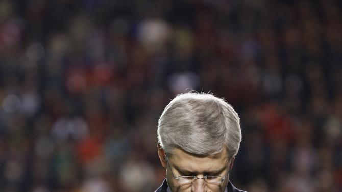 Canada's PM Harper takes part in a tribute to recently fallen soldiers, prior to an Ottawa Redblacks CFL football game in Ottawa