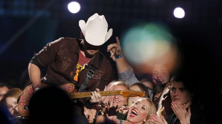 "Fans react as Brad Paisley performs ""The Mona Lisa"" during the 4th annual American Country Awards in Las Vegas"