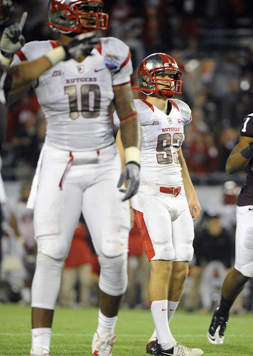Rutgers kicker Nick Borgese (93) and tight end D.C. Jefferson (10) watch Borgese's field goal-attempt go wide right in overtime during an NCAA college football Russell Athletic Bowl game against Virgi