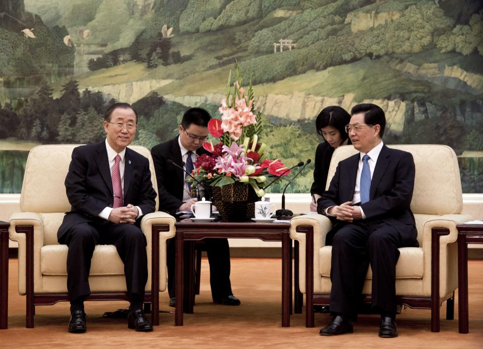 U.N. Secretary-General Ban Ki-moon, left, meets with Chinese President Hu Jintao at the Great Hall of the People in Beijing, China Wednesday, July 18, 2012. (AP Photo/Andy Wong, Pool)