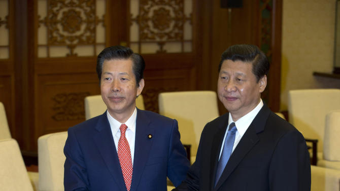 Natsuo Yamaguchi, left, leader of the New Komeito party from Japan, shakes hands with Chinese Communist party Secretary General Xi Jinping, during a meeting at the Great Hall of the People in Beijing, China, Friday, Jan. 25, 2013. (AP Photo/Ng Han Guan, Pool)