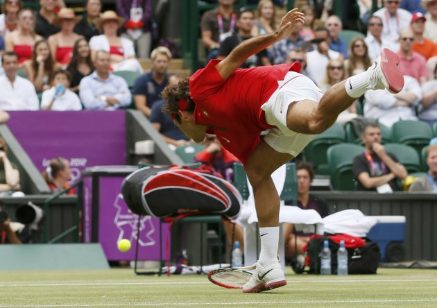 Switzerland's Federer misses a return to Argentina's del Potro in their men's singles tennis semi-final match at the All England Lawn Tennis Club during the London 2012 Olympic Games