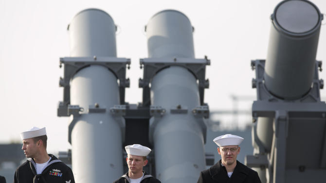 Sailors man the rails aboard the guided -missile destroyer USS Barry as the ship departs the Norfolk Naval Station, Thursday morning, Feb. 7, 2013 for a 6-month deployment. The USS Barry has deployed to Europe to protect U.S. allies from ballistic missiles.  (AP Photo/TheVirginian-Pilot,Bill Tiernan)  MAGS OUT