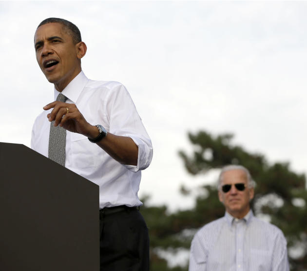 Vice President Joe Biden listens at right as President Barack Obama speaks during a campaign event at Triangle Park in Dayton, Ohio, Tuesday, Oct. 23, 2012, the day after the last presidential debate
