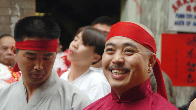"""FILE - In this Aug. 6, 2006 file photo, Raymond """"Shrimp Boy"""" Chow smiles after being sworn in as the """"Dragon Head"""" of the Chee Kung Tong in Chinatown in San Francisco. Chow, a central figure in a sweeping San Francisco organized crime and public corruption case, pleaded not guilty. The FBI spent many millions of dollars and used more than a dozen undercover operatives posing as honest businessmen and Mafia figures alike during its seven year organized crime investigation centered in San Francisco's Chinatown. Now, an increasing number of the defendants caught up in the probe that has ensnared a state senator and an aide are arguing that the FBI and its undercover agents are guilty of entrapment, luring otherwise honest people to go along with criminal schemes hatched by federal officials. (AP Photo/Sing Tao Daily, File)"""