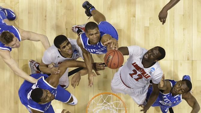 Kentucky's Dakari Johnson (44), Aaron Harrison (2) and Dominique Hawkins (25) go after a rebound with Louisville's Wayne Blackshear (20) and Akoy Agau (22) during the first half of an NCAA Midwest Regional semifinal college basketball tournament game Friday, March 28, 2014, in Indianapolis. (AP Photo/Michael Conroy)