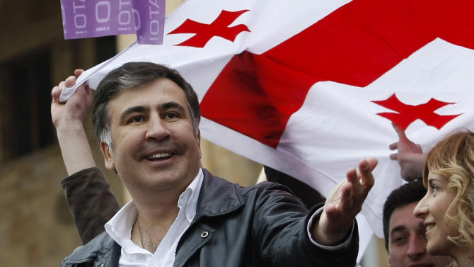 Georgian President Mikhail Saakashvili speaks at a meeting of his supporters in Tbilisi, Georgia, Friday, April 19, 2013. About 10,000 supporters of embattled pro-Western President Mikhail Saakashvili have gathered for a rally testing their strength ahead of October's presidential vote. Saakashvili's United National Movement lost October's parliamentary election to the Georgian Dream bloc led by Russia-friendly billionaire Bidzina Ivanishvili, who became prime minister. Saakashvili's authority has been further weakened by a constitutional reform that has shifted powers from the presidency to Parliament and the prime minister. (AP Photo/Shakh Aivazov)