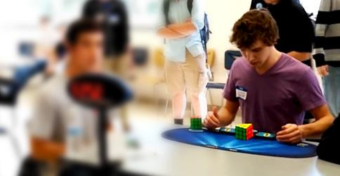 World record! 14-year-old solves Rubik's Cube record in under 5 seconds