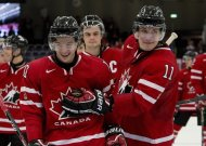 Canada's Charles Hudon (10) and Bo Horvat (11) celebrate as they skate off the ice after defeating the USA 3-2 at the IIHF World Junior Hockey Championships in Malmo, Sweden on Tuesday December 31, 2013. THE CANADIAN PRESS/ Frank Gunn
