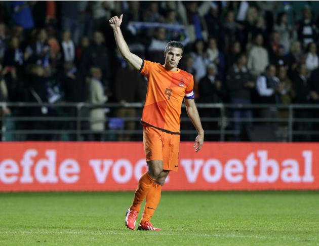 The Netherlands' Robin van Persie gestures to spectators after their World Cup 2014 group D qualifying soccer match against Estonia in Tallinn