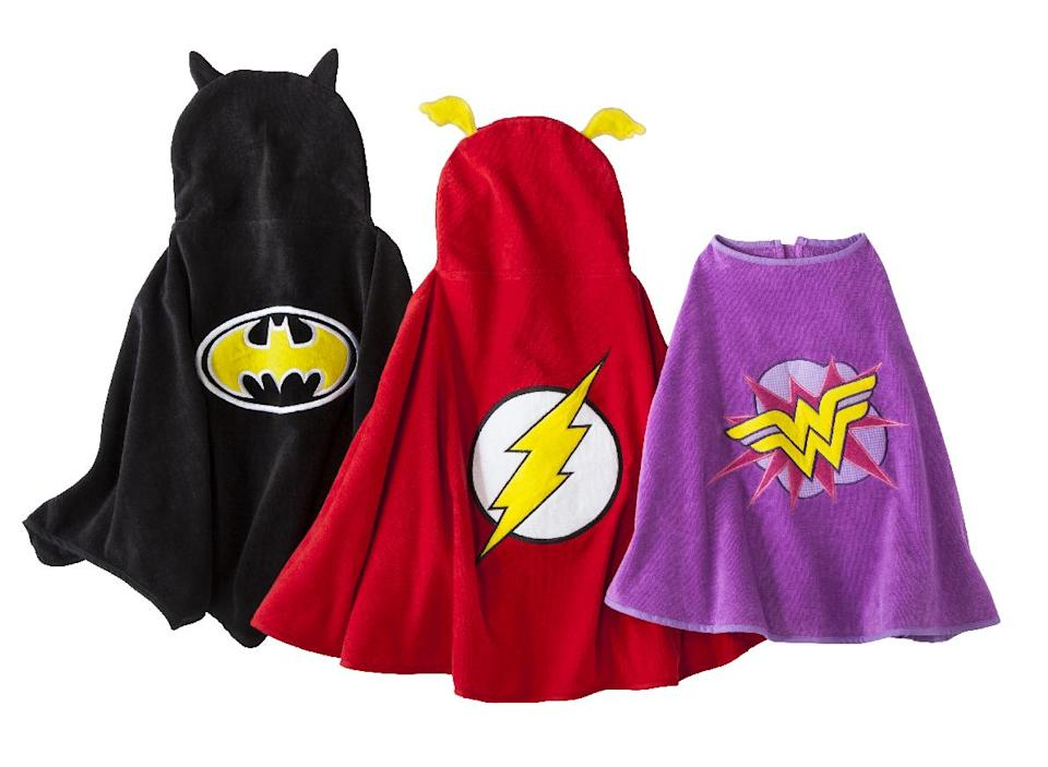 This product image released by target shows superhero-inspired beach towel capes. Along with the sunscreen, book, toys and snacks we haul to our waterside of choice this summer, we need a beach towel or two. These superhero-inspired beach towel capes are a fun way for children to dry off and play at the same time this summer. (AP Photo/Target)