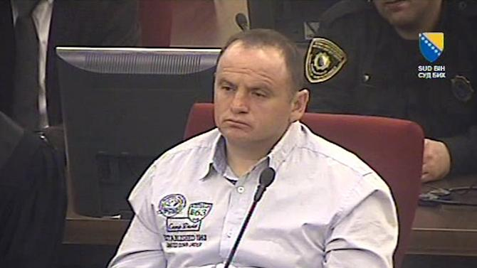 In this screen grab taken from video,  provided by the Court of Bosnia and Herzegovina, Veselin Vlahovic, during his sentencing in court, in Sarajevo, Bosnia and Herzegovina, Friday, March 29, 2013. A court in Bosnia on Friday convicted a Montenegrin man of multiple counts of murder, torture, rape and looting during Bosnia's 1992-95 war, and sentenced him to 45 years in prison — the highest sentence ever issued in the country. Judge Zoran Bozic said that Veselin Vlahovic, killed 31 people, raped a number of Bosniak and Croat women and tortured and robbed non-Serb residents of a Sarajevo suburb while fighting for the Bosnian Serbs. Among other crimes, the judge described how Vlahovic cut the throats of two brothers in front of their mother, then killed her and raped the men's wives. (AP Photo /Court of Bosnia and Herzegovina)