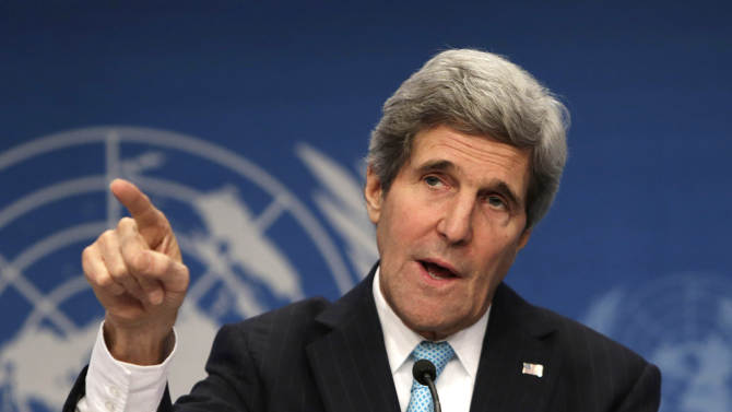 """US Secretary of State John Kerry gestures at a press conference during the Syrian peace talks in Montreux, Switzerland, Wednesday, Jan. 22, 2014. U.N. Secretary-General Ban Ki-moon opened the meeting saying that the peace talks will face """"formidable"""" challenges for Syria. Ban called on the Syrian government and the opposition trying to overthrow it to negotiate in good faith. (AP Photo/Gary Cameron, Pool)"""