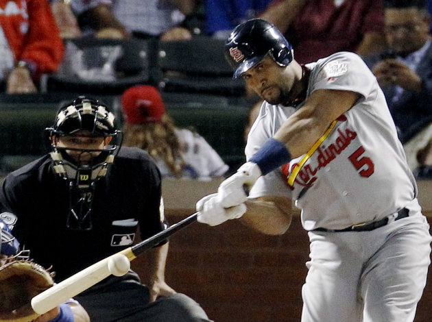 St. Louis Cardinals' Albert Pujols hits a solo home run during the ninth inning of Game 3 of baseball's World Series against the Texas Rangers, Saturday, Oct. 22, 2011, in Arlington, Texas. (AP Photo/