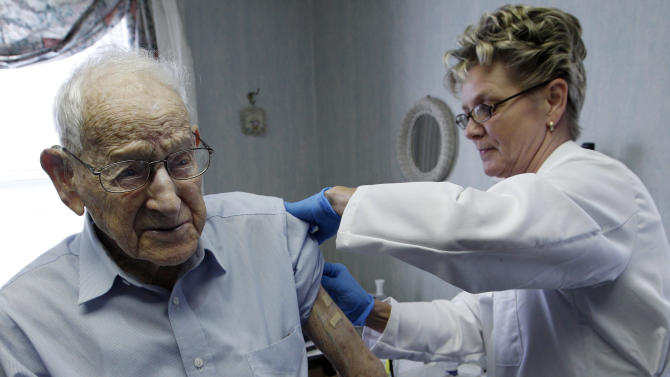 In this Tuesday, Oct. 18, 2011 photo, George Eberhardt, 107, of Chester, NJ. is given his annual flu shot by nurse Bettie Donnelly in Mendham, N.J. Babies and toddlers were more likely to get the flu vaccine last year than people over 65. Both groups are more vulnerable to flu than other age groups. Government data released Thursday, Sept. 27, 2012 also showed a wide range of vaccine protection across the country. (AP Photo/Mel Evans)