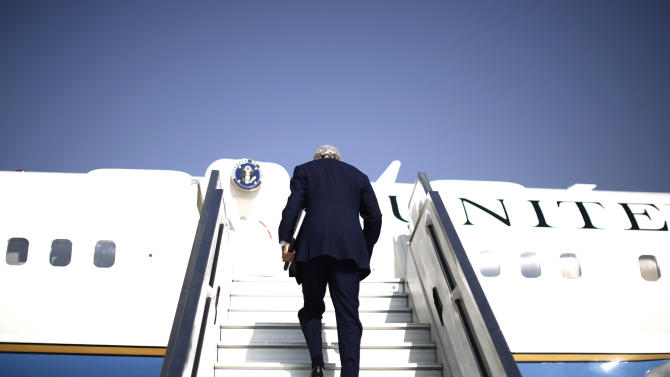 "U.S. Secretary of State John Kerry steps aboard his aircraft en route to Geneva after meeting with Israeli Prime Minister Benjamin Netanyahu in Tel Aviv, Israel, Friday, Nov. 8, 2013. Netanyahu, before meeting with Kerry, said Friday that he ""utterly rejects"" the emerging nuclear deal between western powers and Iran, calling it a ""bad deal"" and promising that Israel will do everything it needs to do to defend itself. (AP Photo/Jason Reed, Pool)"