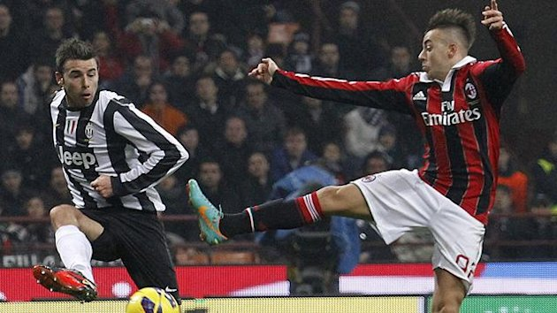 AC Milan's Stephan El Shaarawy (R) and Juventus' Andrea Barzagli fight for the ball (Reuters)
