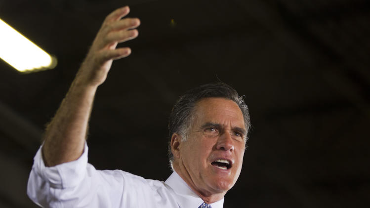 Republican presidential candidate, former Massachusetts Gov. Mitt Romney gestures during a campaign stop at Con-Air Industries, Tuesday, June 12, 2012, in Orlando, Fla.  (AP Photo/Evan Vucci)