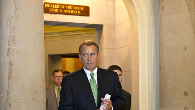 FILE - In this Tuesday, Dec. 11, 2012, file photo, House Speaker John Boehner of Ohio leaves his office and walks to the House floor to deliver remarks about negotiations with President Obama on the fiscal cliff, on Capitol Hill in Washington. Even if Congress and the White House fail to strike a budget deal by New Year's Day, reality may be a lot less bleak then the scenario that's been spooking employers and investors and slowing the U.S. Economy. The tax increases and spending cuts could be retroactively repealed after Jan. (AP Photo/J. Scott Applewhite)