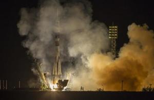Soyuz TMA-10M spacecraft carrying the International Space Station crew blasts off from the launch pad at the Baikonur cosmodrome