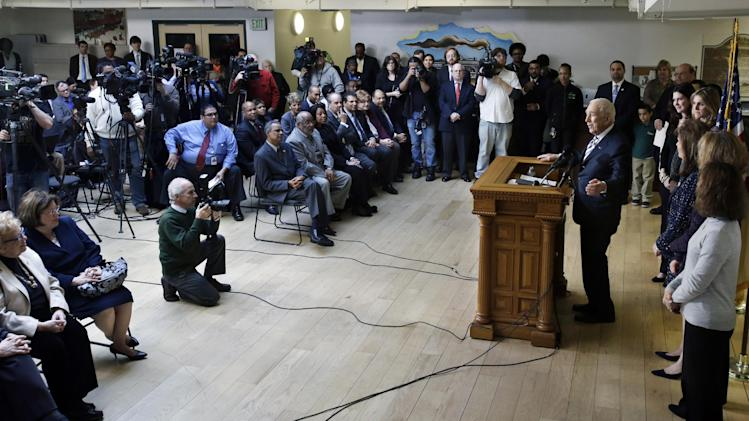 Sen. Frank Lautenberg, 89,at podium, the oldest member of the U.S. Senate, tells a gathering Friday, Feb. 15, 2013, in his hometown of Paterson, N.J., that he plans to retire at the end of his current term. His decision eliminates a probable primary battle with Cory Booker, the charismatic mayor or Newark, and possibly others including Democratic Rep. Frank Pallone, who is also mulling a run. (AP Photo/Mel Evans)
