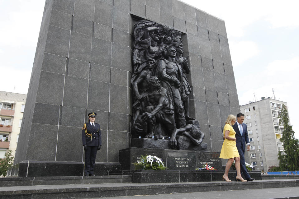 Republican presidential candidate and former Massachusetts Gov. Mitt Romney and wife Ann visit the Monument to the Ghetto Heroes in Warsaw, Poland, Tuesday, July 31, 2012. (AP Photo/Charles Dharapak)