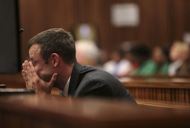 Olympic and Paralympic track star Pistorius reacts in dock during his trial for murder of his girlfriend Steenkamp, at North Gauteng High Court in Pretoria