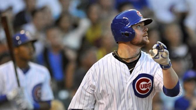 Chicago Cubs starting pitcher Jon Lester flies out during the second inning of a baseball game against the Washington Nationals in Chicago, Wednesday, May 27, 2015. (AP Photo/Paul Beaty)