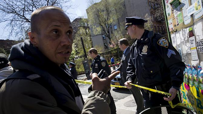 A man tries to gain street access as police close it down near the scene of a shooting in New York City