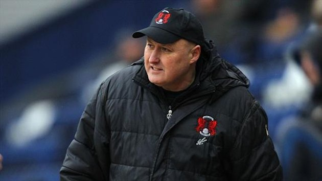 Russell Slade, pictured, has made Yohann Lasimant his latest signing