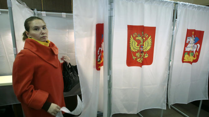 A woman votes at a polling station in the town of Khimki outside Moscow, Russia, Sunday, Oct. 14, 2012. Russians are casting ballots in local elections that offer a degree of political competition but still remain tightly controlled by President Vladimir Putin's government. One of the most visible races Sunday is that for mayor of the town of Khimki, just outside Moscow. (AP Photo/Mikhail Metzel)