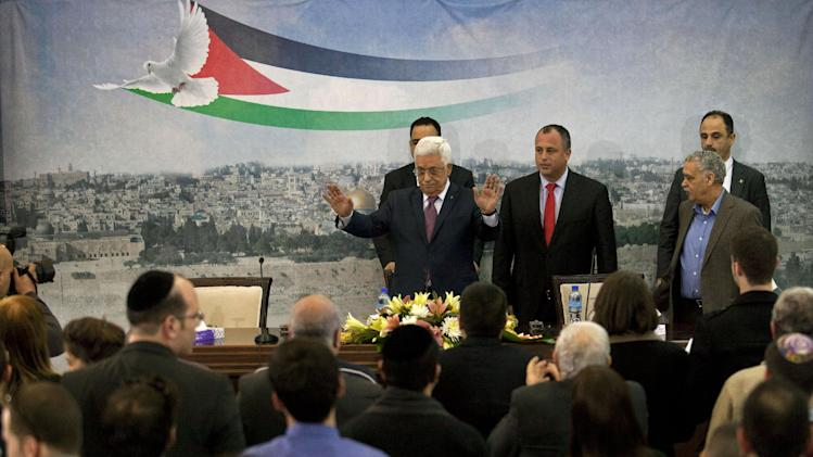 "Palestinian President Mahmoud Abbas, top left, and Israeli Labor party lawmaker Hilik Bar, top second left, arrive for a meeting with a delegation of mostly Israeli university students and activists in dovish political parties, at his compound in the West Bank city of Ramallah, Sunday, Feb. 16, 2014. Abbas said that he does not want to ""drown Israel with millions of (Palestinian) refugees to change its nature."" Abbas' comment Sunday was his most conciliatory yet on the fate of Palestinian refugees who were uprooted from homes in what is now Israel, including in the 1948 war over Israel's creation. (AP Photo/Nasser Nasser)"