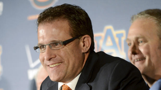 Newly hired Auburn head coach Gus Malzahn smiles during an NCAA college football news conference, Tuesday, Dec. 4, 2012, in Auburn, Ala. Malzahn received a five-year contract worth $2.3 million annually to try to get the team back on solid footing. (AP Photo/AL.com, Julie Bennett)  MAGS OUT