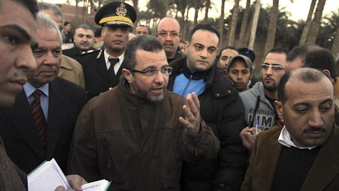Egyptian Prime Minister Hesham Kandil pays a visit to the site of a train crash in Badrasheen, 40 KM south of Cairo, Egypt, Tuesday, Jan. 15, 2013. At least 19 people died and more than 100 were injured when two railroad passenger cars derailed just south of Cairo, health officials say. The accident comes less than two weeks after a new transportation minister was appointed to overhaul the rail system, and just two months after a deadly collision between a train and school bus. (AP Photo/Ahmed Gomaa)
