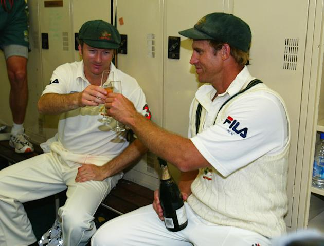 Matthew Hayden of Australia shares a glass of champagne with his captain Steve Waugh