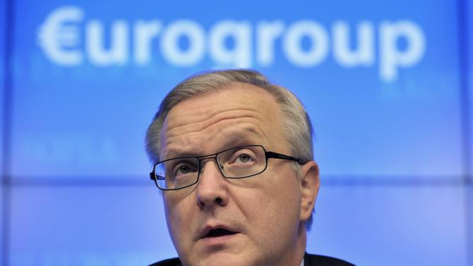 File photo of Rehn holding a news conference after a Eurogroup meeting in Brussels
