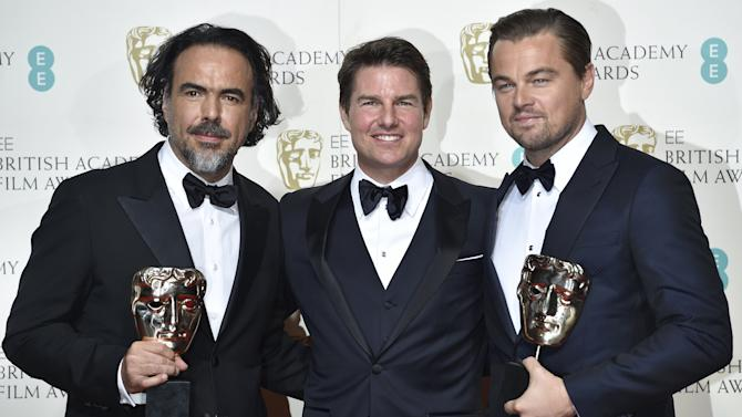Best director Alejandro Inarritu and best leading actor Leonardo DiCaprio hold their awards as they stand with presenter Tom Cruise at the British Academy of Film and Television Arts (BAFTA) Awards at the Royal Opera House in London