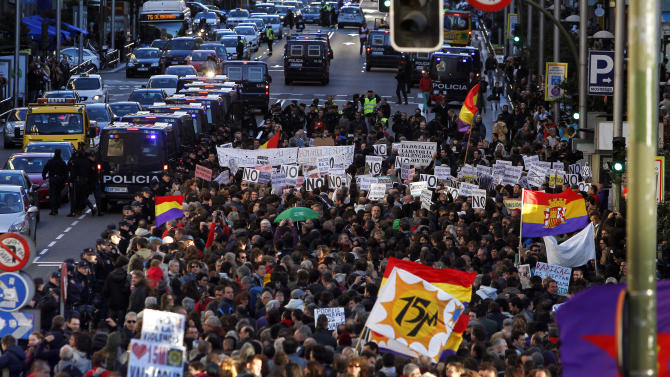 Protestors march to the parliament against austerity measures announced by the Spanish government in Madrid, Spain, Saturday, Oct. 27, 2012. Prime Minister Mariano Rajoy's government has hiked taxes, cut spending, including a wage-cut for civil servants, and introduced stinging labor reforms in a bid to persuade investors and international authorities that he can manage Spain's finances without the need for a full-blown bailout. However, Spain's public finances have been overwhelmed by the cost of rescuing some of its banks and regional governments, many of which have experienced heavy losses following a property sector crash in 2008. One Spaniard in four is unemployed as the economic crisis tightens its grip.  (AP Photo/Andres Kudacki)