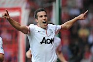 Manchester United's Robin van Persie (C) celebrates scoring his 3rd goal during their English Premier League match vs Southampton at St Mary's in Southampton, on September 2