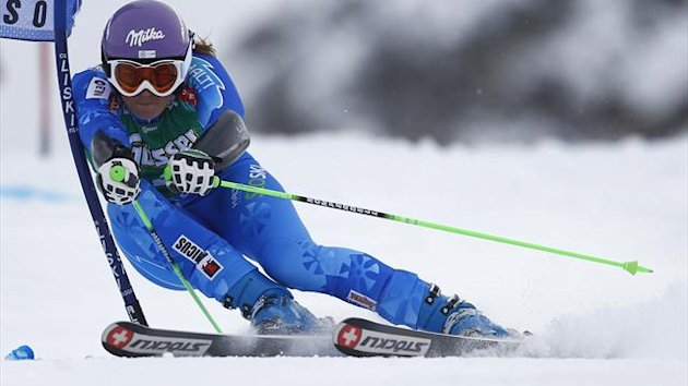 Tina Maze of Slovenia clears a gate during the first run of the World Cup Soelden Women's Giant Slalom on the Rettenbach glacier in the Tyrolean ski resort of Soelden