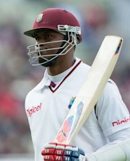West Indies Marlon Samuels leaves the pitch after scoring 76 runs during the third day of the third Test match between England and West Indies in Birmingham, central England