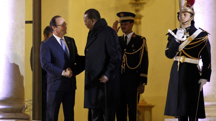 French President Hollande talks with Chad's President Idriss Deby after a meeting dedicated to the situation in the Central African Republic, at the Elysee Palace at the end of the Elysee Summit for Peace and Security in Africa, in Paris