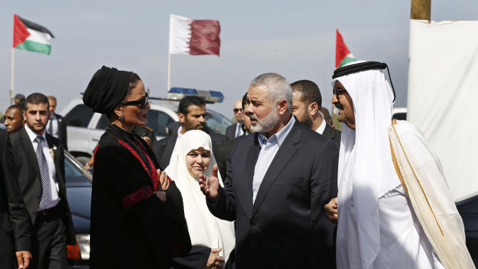 Emir of Qatar Sheikh Hamad bin Khalifa al-Thani, right, his wife Qatar's First Lady Sheika Mozah bint Nasser al-Missned, left, Gaza's Hamas prime minister Ismail Haniyeh, second right, and his wife Amal Haniyeh, second left, arrive for the corner-stone laying ceremony for Hamad, a new residential neighborhood in Khan Younis, southern Gaza Strip Tuesday, Oct. 23, 2012. The emir of Qatar received a hero's welcome in Gaza on Tuesday, becoming the first head of state to visit the Palestinian territory since the Islamist militant Hamas seized control there in 2007. (AP Photo/Mohammed Salem, Pool)
