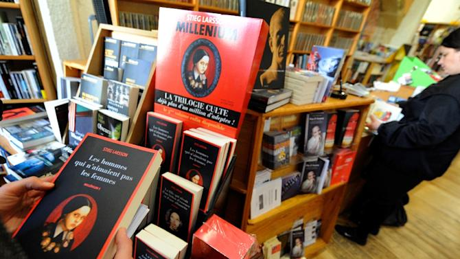"Customers browse copies of ""The Girl With a Dragon Tattoo,"" the first volume of the Millennium trilogy by Swedish author Stieg Larsson, at a bookstore in Arles, France on February 25, 2009"