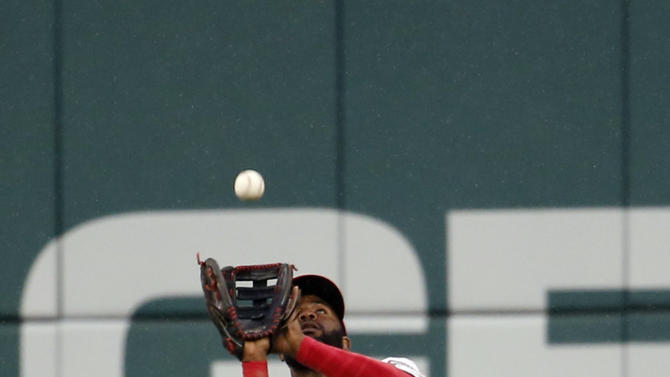 Washington Nationals center fielder Denard Span (2) catches a fly ball hit by San Francisco Giants' Brandon Crawford for an out during the fifth inning of a baseball game at Nationals Park, Friday, July 3, 2015, in Washington. (AP Photo/Alex Brandon)
