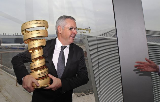 Ireland's former Tour de France winner, Stephen Roche, poses with the Giro d'Italia trophy at the Titanic Centre in Belfast