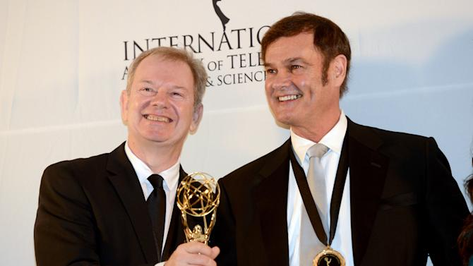 """Australians Zane Bair, left, and Michael McKay after winning the Non-Scripted Entertainment award for """"The Amazing Race Australia"""" at the 40th International Emmy Awards,  Monday, Nov. 19, 2012 in New York. (AP Photo/Henny Ray Abrams)"""